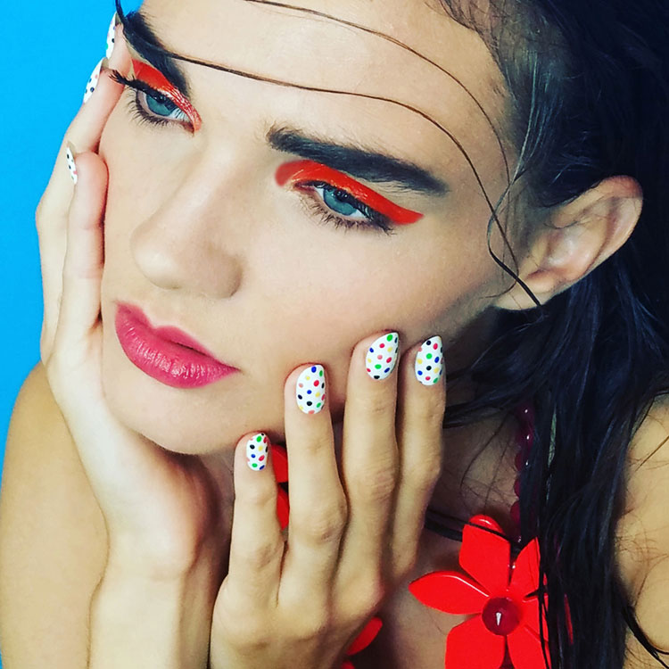 red eyeshadow and glossy eye makeup