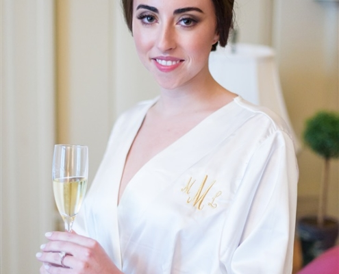 Bride drinking champagne in Lake Forest